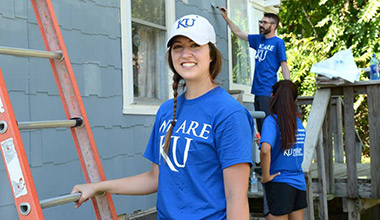 Students repainting homes in the community